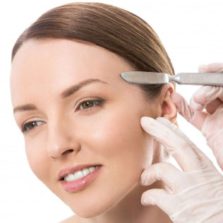 Close up of woman receiving a dermaplaning facial